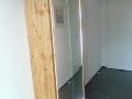 Badezimmerschrank aus Lärche mit LED Detail